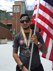 Yarek Locia-Lorenzo carried the flag during the entire Spartan Race, running for RWB - a team that supports military veterans.