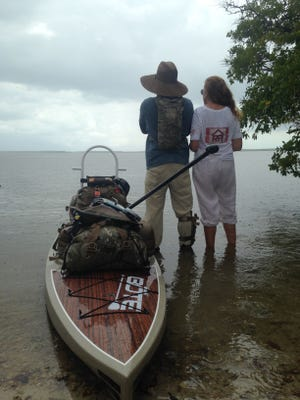 Cynthia Trone overlooks the Florida Everglades with environmental activist Justin Riney during Riney's paddleboard expeditions, which focused on environmental, historical and community awareness in Florida.