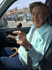 Julia Chodzinski poses with a cake pop from Moia Meals.