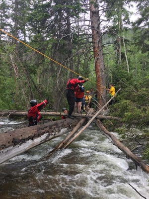 Rescuers retrieve a woman from the St. Vrain River on July 5, 2017.