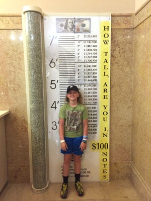 Harrison Hunger, 10, from Franklin, took the D to United States Department of Engraving in Washington D.C. as part of a weekend trip to view the various sites by his grandparents Joy and Allan Nachman of Bloomfield Hills. At his height in shredded $100 notes, he is worth $1,374,700.