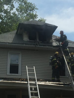 Vineland firefighters battled a fire in the attic area of a house at East Avenue and Spruce Street Thursday afternoon.