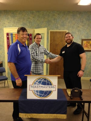 Wichita Falls Toastmasters Club No. 305 member Tom Merritt, center, welcomes the 2017-18 Area 51 Director, Michael Battaglino, right, at a recent weekly meeting as president Scott Plowman observes