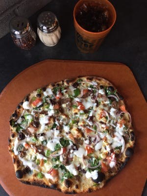 The Gyro Pizza at BYOPizza has olive oil, a four-cheese blend, feta, gyro meat, spinach, tomatoes, red onions, green peppers and tzatziki sauce.