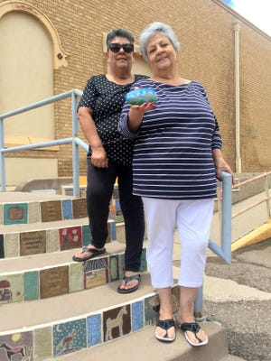 Rachel Tais and Gloria Grinie hold a rock that was painted of the Kneeling Nun and part of the Rockin' Rocks group that has taken Silver City and Grant County by storm. Tais is one of the co-founders, while Grinie's daughter brought the fad to Silver City.