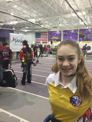 Charlotte Adams smiles after earning a national record