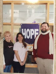 Tiffany Smith, center, is pictured in this 2015 photograph with Linda Nyborg and the Rev. Will Baker at an anti-cancer event at Drummondtown Baptist Church in Accomac, Virginia.