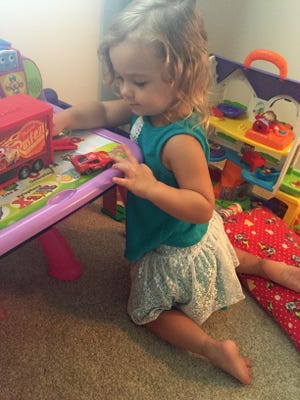 Wherever you find Isabella, her Lightning McQueen toy car isn't far behind.