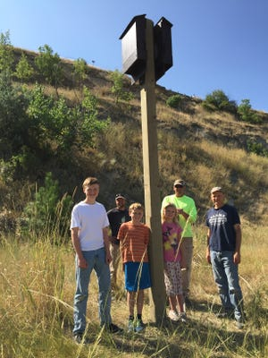 From the left: Adam Blake, Henry Blake, Emmaline Blake, Steffen Janikula and Rodney Blake installed six bat houses on the River's Edge Trail as part of Adam's Eagle Scout project.