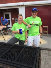 Kelsey Sutter, left, and Drew Mogler stand at the grills out front of the Iowa Pork Tent on the opening day of the 2017 Iowa State Fair. While they will welcome a steady stream of celebrity chefs, this year brings relatively few political candidates.