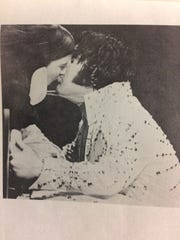 Elvis Presley kisses a fan in the crowd at a 1974 performance at Middle Tennessee State University. The image appeared in the May 1974 edition of Collage magazine.