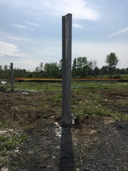 One of what will eventually be about 3,700 poles stands in a field under construction for a solar project at Dreamwalker Farm in Grand Isle on Friday, Aug. 11, 2017. When complete, the solar farm will be one of the largest in Vermont.