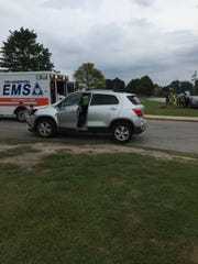 Rescue crews are at the scene of a crash at Court and