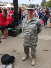 Tonya Adams, a staff sergeant from Iowa City in the 34th Army Band, pauses Monday, Aug. 14, 2017, during the Iowa State Fair Veterans Day Parade.