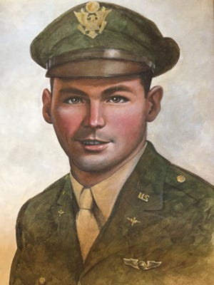 This painting of Lt. John Murphy was displayed in the VFW in Delta that was named in his memory. Earlier this year, the post closed, and recently, Murphy's cousins came to retrieve the painting and some of Murphy's medals. Murphy was lost during World War II when his plane went down over eastern Germany. He and the other members of his crew were able to parachute safely to the ground, but he and three others were separated from the rest of the crew. They were never seen again. Earlier this year, a German researcher started investigating the case. He thinks he might be able to figure out what happened to Murphy and the others.