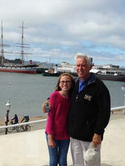 Abigail Plylar poses with her grandfather Ron.