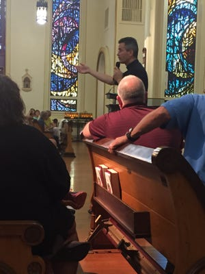 Father David Sizemore speaks to St. Francis de Sales parishioners at a town hall meeting Aug. 9. The congregation was there to discuss options for a new parish rectory.