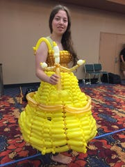 Beth Patton, of Carmel, fashioned her GenCon costume from about 100 balloons for GenCon on Saturday, Aug. 19, 2017.