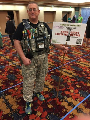 Vic Mitchell is a costume corpsman who fixes costumes on site at different conventions. He was at GenCon on Saturday, Aug. 19, 2017.