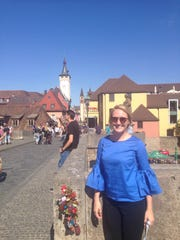 Wauwatosa West High School teacher Ana Baker stands by a bridge in Wurzburg, Germany, the second stop on her trip through the country with the Transatlantic Outreach Program.