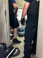 Newark medics and police revive a man at the Speedway on West Main Street after he overdosed on the restroom floor, his head under the sink, feet in front of the toilet Wednesday, July 12.  The overdose antidote naloxone, sprayed into his nostrils, didn't work. The medics used a drill, pushing a tiny hole into a shin bone. The medics administer one dose of naloxone, then another before he is revived.