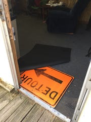 An old street sign reinforces the sagging floor in