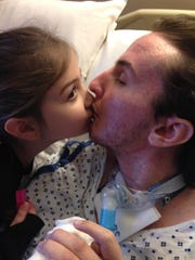 Patrick Hall's 6-year-old daughter, Milaniah, visits him nearly every week at the nursing home near Philadelphia.
