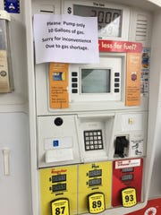 A sign at an Asheville gas station asks buyers to limit