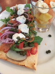 One of the many brunch items at Blue's Egg, 317 N. 76th St., is smoked salmon flatbread, served with fresh fruit.