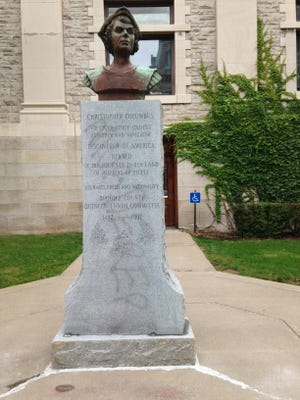 """The word """"murderer"""" can be seen on a statue of Christopher Columbus outside the Broome County Courthouse."""