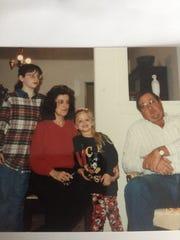 Harper Grae, 6, center, with her grandparents, Mimi
