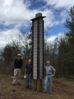 EMAS president Tom Tribble, center, stands by a chimney swift tower members of the Elisha Mitchell Audubon Society built to help the migrating birds.