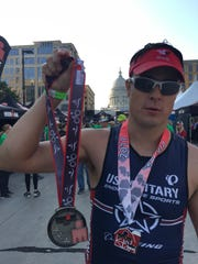 Jake Dallmann completed IRONAM despite having to push his bike on the final 12 miles of the ride.