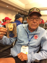 Stewart Johnson, a retired Milwaukee police officer, took a picture of a medal he received in Vietnam for saving someone's life to place beneath the name of a fallen buddy at the Vietnam Memorial in Washington, D.C., during a Stars and Stripes Honor Flight.