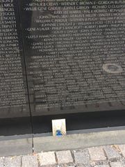 Stewart Johnson placed this photo of a medal he was awarded in Vietnam on the section of the Vietnam Memorial in Washington, D.C., where his buddy's name is listed.