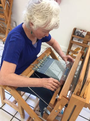 Black Mountain resident Marian Sinks works at a loom during a previous weaving class at Local Cloth.