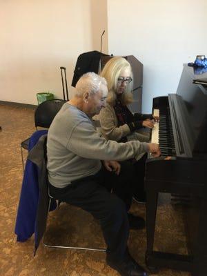 Gerardo Frassino of Carmel, 97, plays the piano with Music Therapist Melinda Burgard at the Mahopac Music Social.