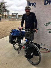 Holger Franz paused in Shelby on his bicycle ride across