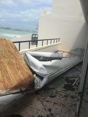Ripped away, part of the roof was carried by the hurricane