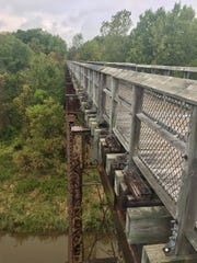 A former railway trestle soaring 60 feet above Mill