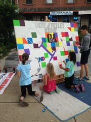 Children painted outsdie of the Blue Streak Gallery at last year's Taste of Trolley Square event in Wilmington.