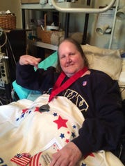 Navy veteran Cynthia Hall smiles after a Samaritan Hospice end-of-life recognition ritual for military veterans in August before her passing.