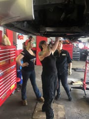 Banks has six female mechanics working at her Girls Auto Clinic in West Darby, Pennsylvania. It's right next to Clutch Beauty Shop.