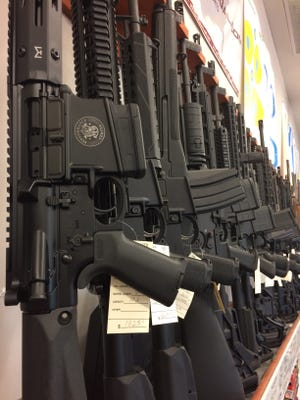 AR-15 rifles are displayed for sale at Guns and Leather in Greenbrier, Tenn.