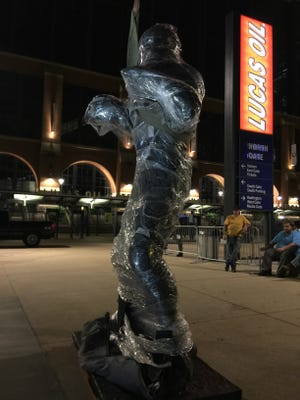 The Peyton Manning stature, wrapped in plastic late Thursday night. The bronze statue won't be unveiled until 3 p.m. Saturday.