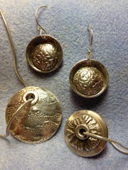 Textures figure in Starr Payne's metallic jewelry.