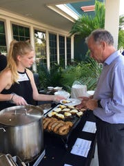 Estero High School Student, Samantha was among those who helped serve food at the 2016 RocktOberfest.