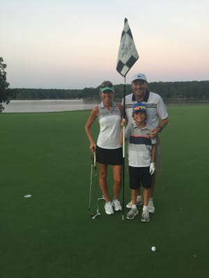 Dan Mullen on the golf course with his wife Megan and son Canon.