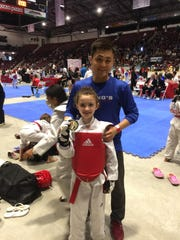 Olivia Liljeros poses with a medal from an international Taekwondo competition.