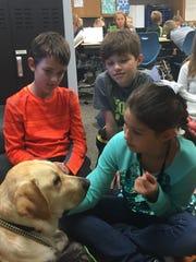 Haven Mixter pets Duncan, Maltby Intermediate School's